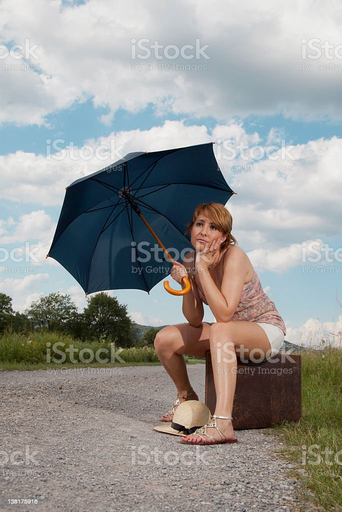 Girl waiting by the road stock photo