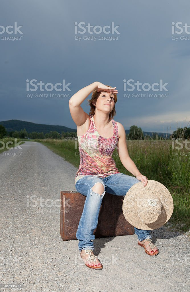 Girl waiting for the car stock photo