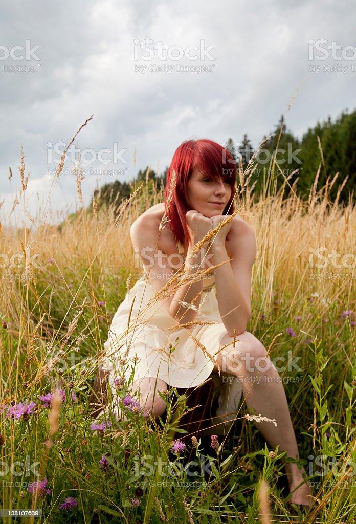 Girl waiting in nature stock photo