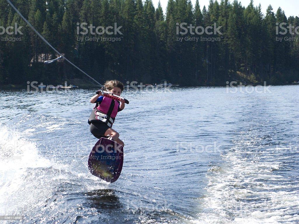Girl wake boarding. royalty-free stock photo