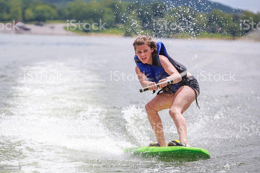Girl wake boarding stock photo