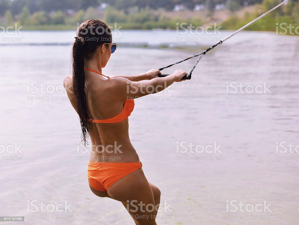Girl wakeboarder enjoying water sports boarding stock photo