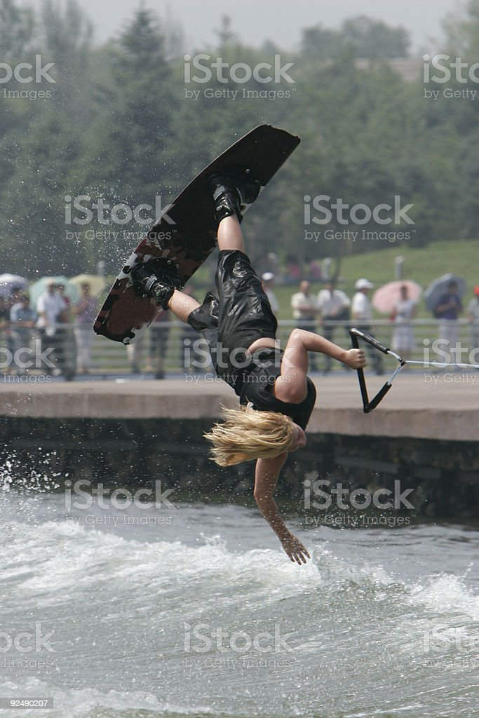 Girl wakeboarder flipping royalty-free stock photo