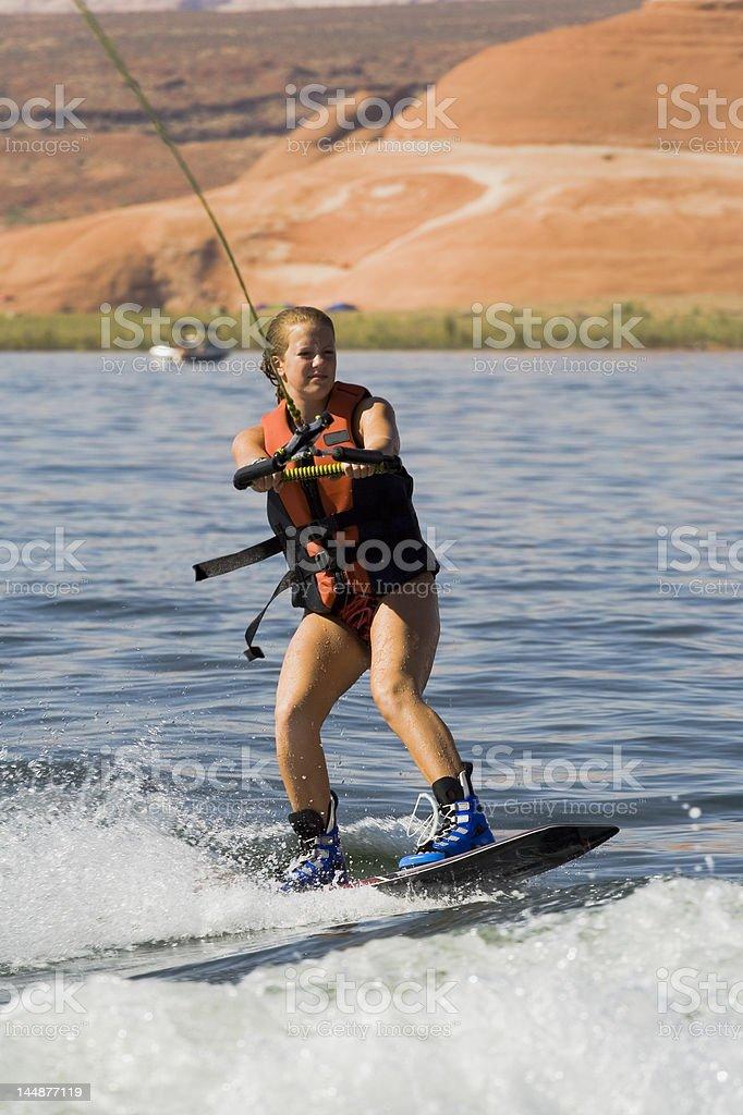 Girl Wakeboarding at Lake Powell royalty-free stock photo