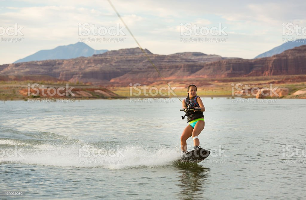 Girl Wakeboarding in Desert Sunshine stock photo