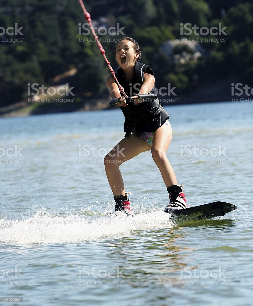 Girl wakeboarding stock photo