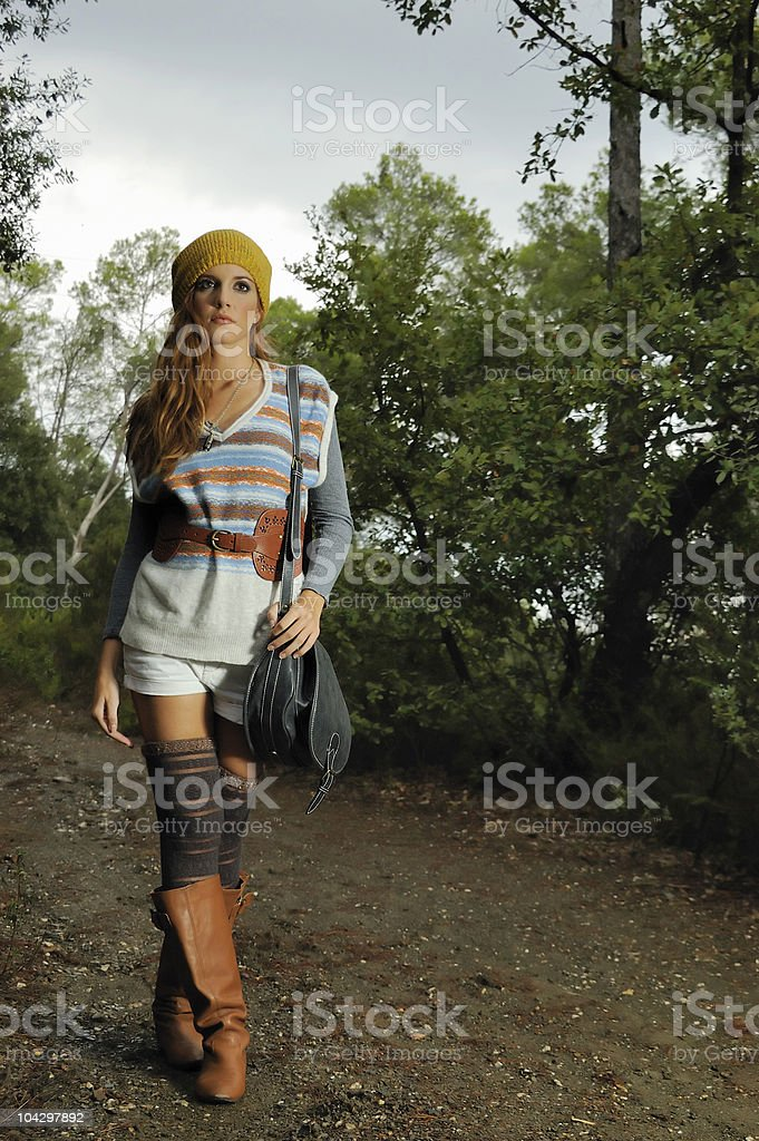 Girl walking by the forest royalty-free stock photo