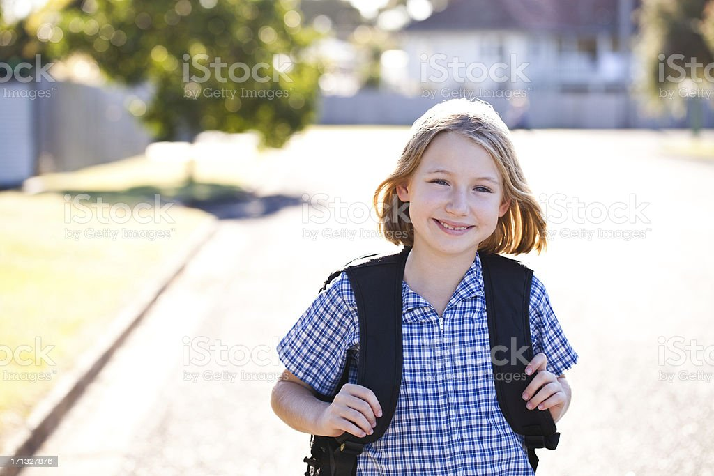 Girl walking home from school stock photo