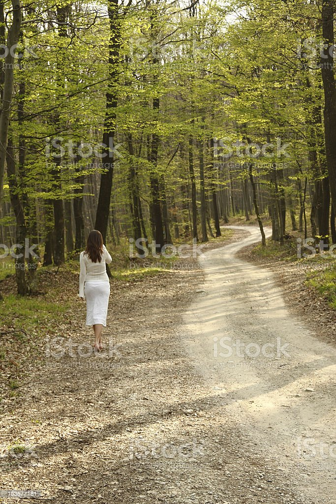 Girl walking in forest stock photo