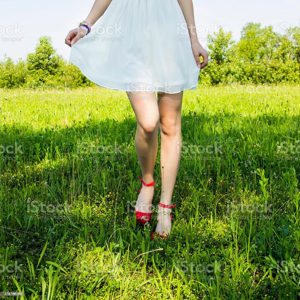 Girl walking in the field stock photo