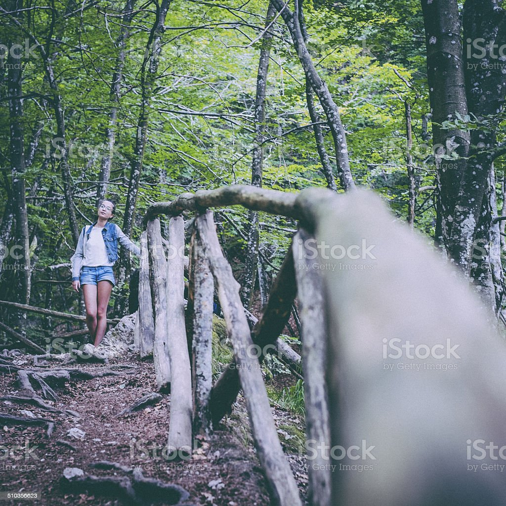 Girl walking in the forest stock photo