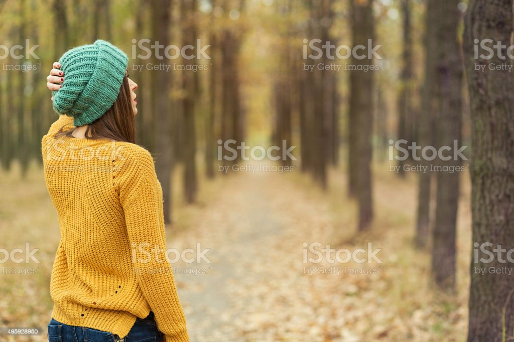 Girl walking in the park stock photo