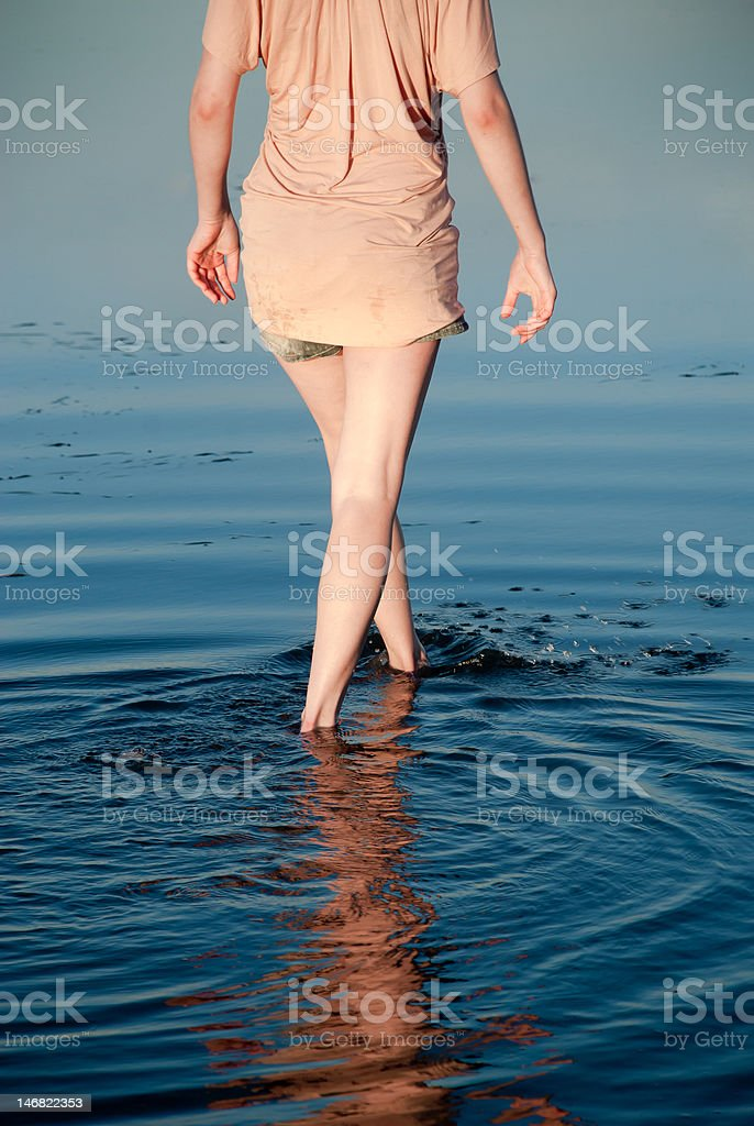 Girl walking in water royalty-free stock photo