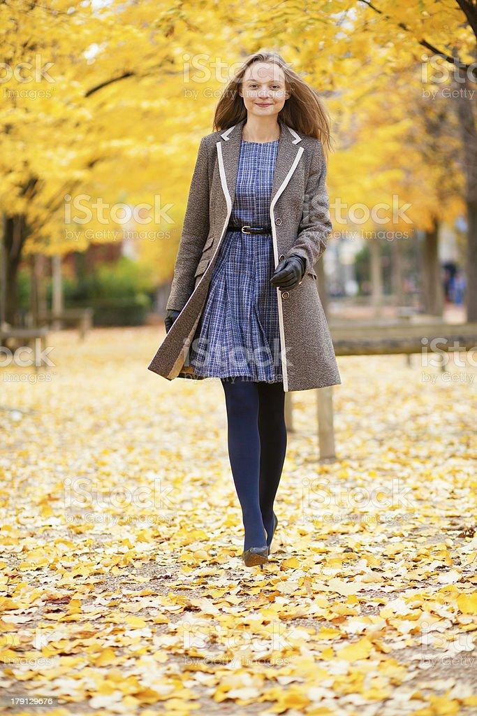 Girl walking on a beautiful fall day royalty-free stock photo