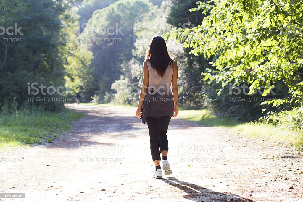 girl walking on a forest trail royalty-free stock photo