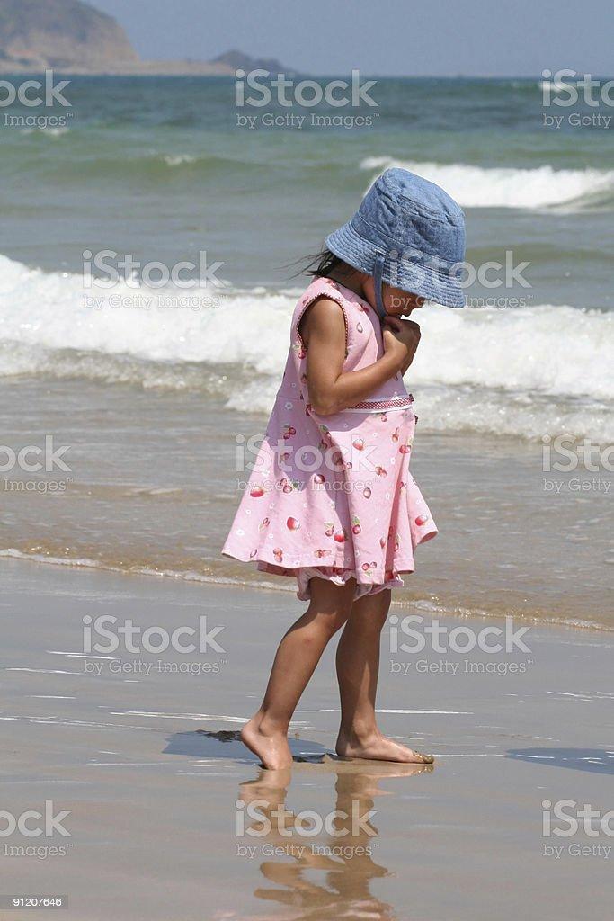 Girl walking on beach royalty-free stock photo