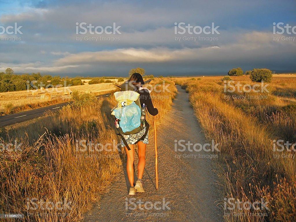 Girl walking on Camino de Santiago stock photo