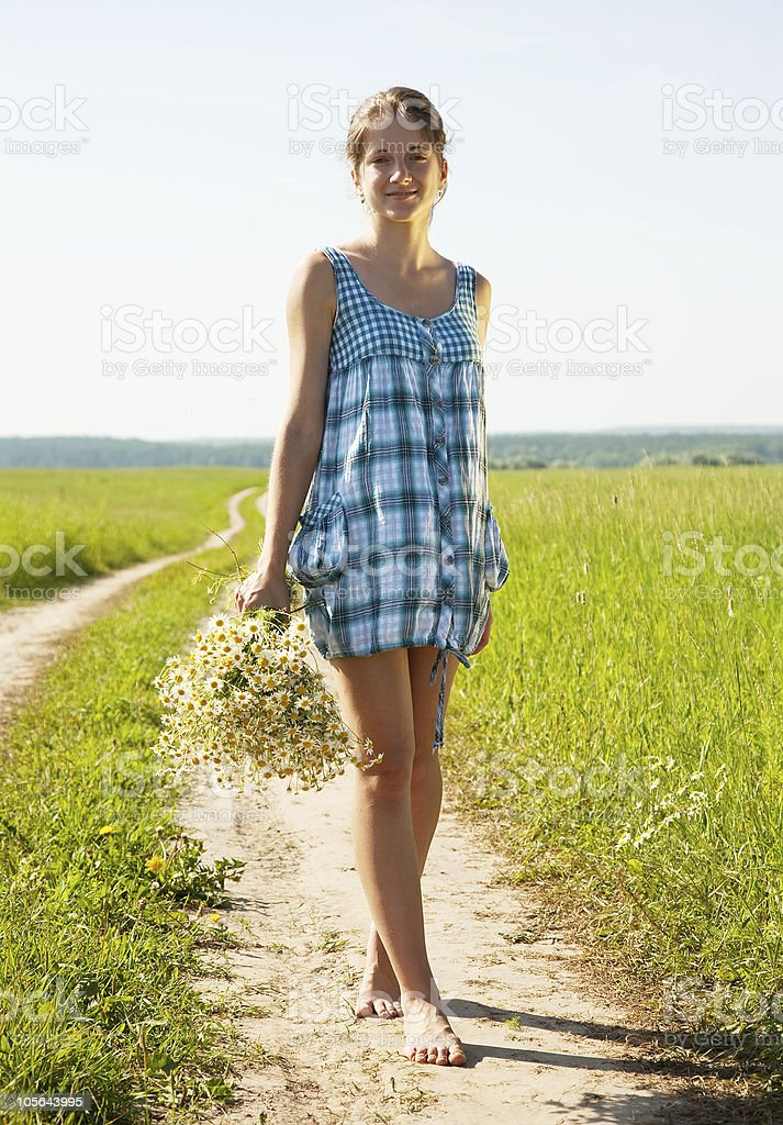 girl walking on country road royalty-free stock photo