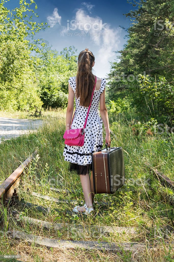Girl walking on railroad stock photo