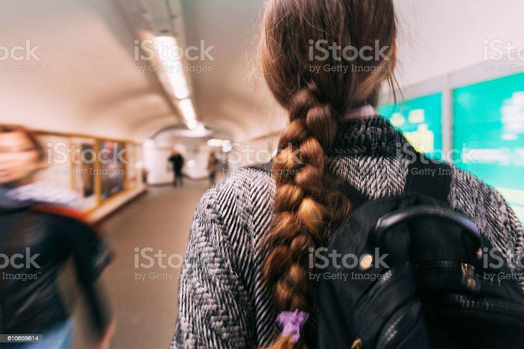 Girl walking on underground subway station - Blurred Motion stock photo