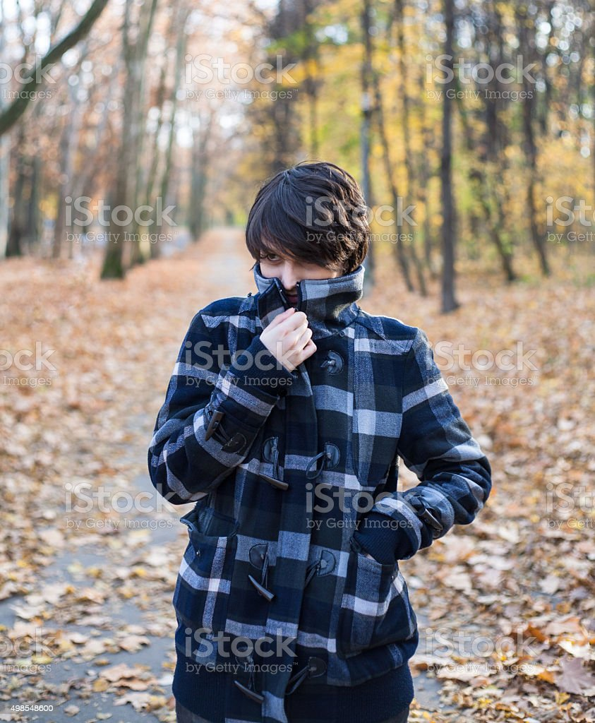 Girl walking outdoors in cold weather royalty-free stock photo