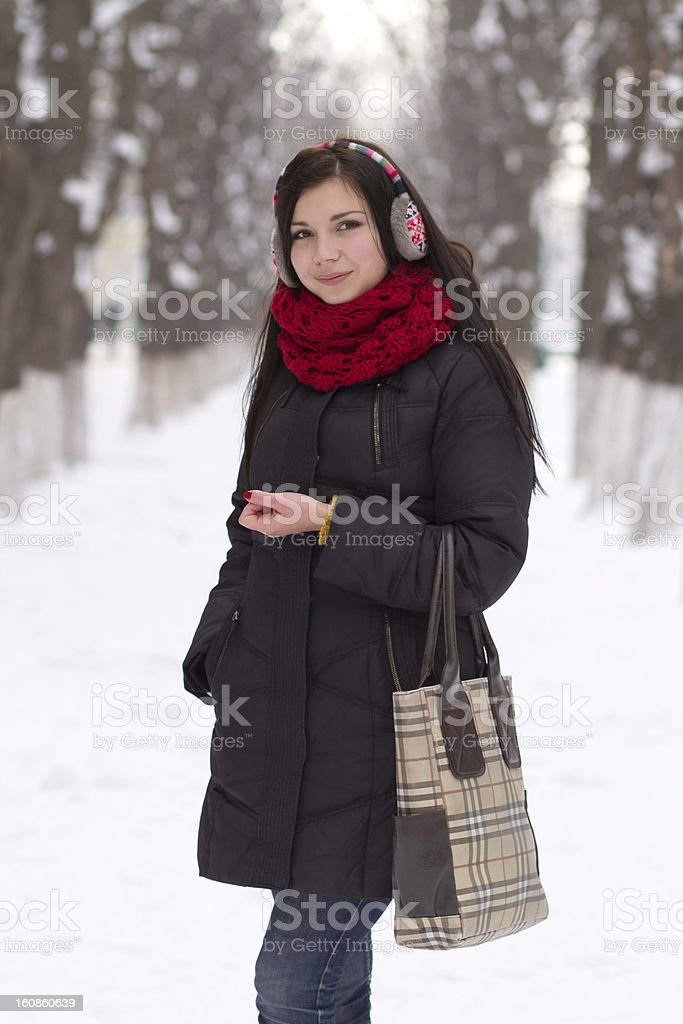 Girl walking outdoors in winter royalty-free stock photo