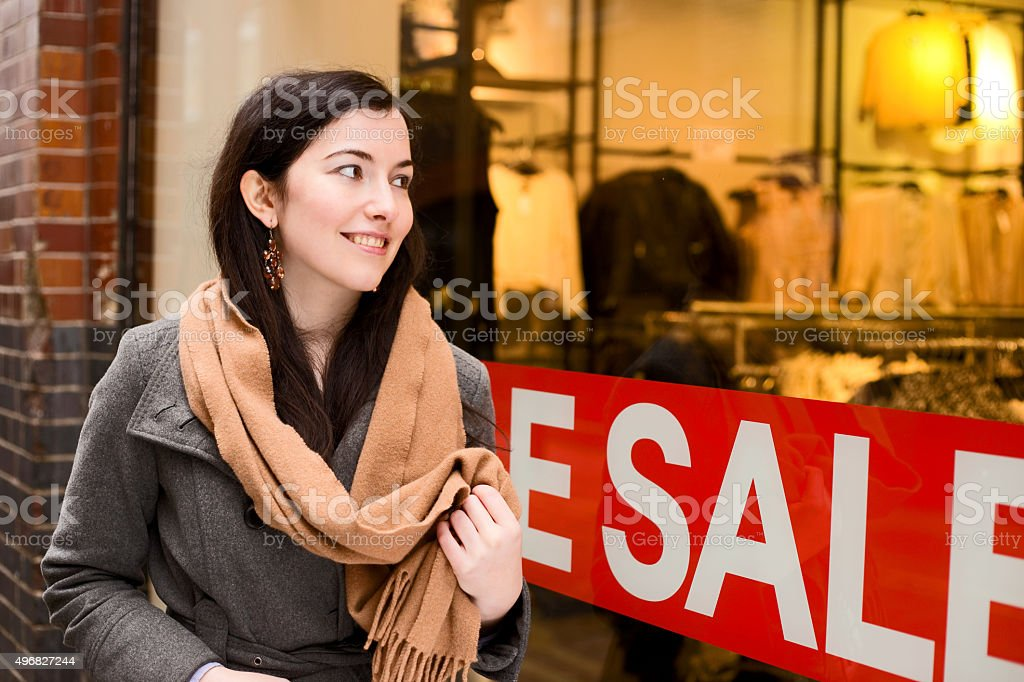 girl walking past the shops royalty-free stock photo