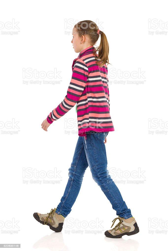 Girl Walking Side View stock photo
