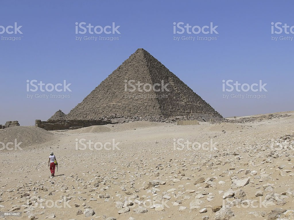 Girl walking to Keops Pyramid royalty-free stock photo