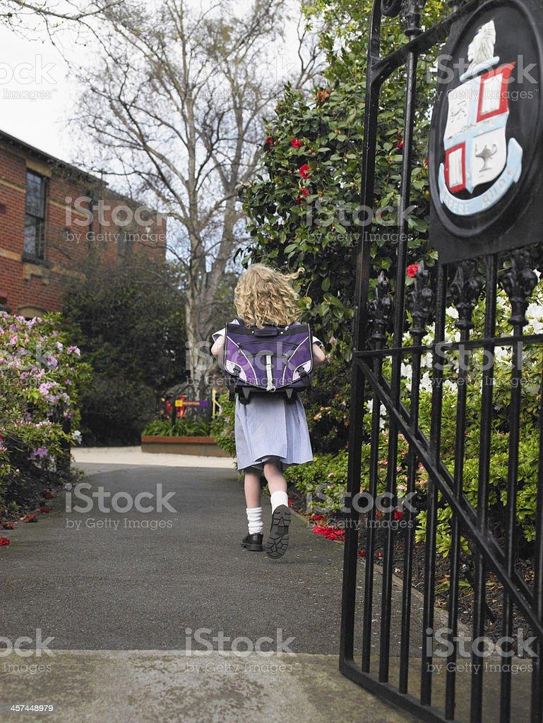 Girl Walking to School stock photo