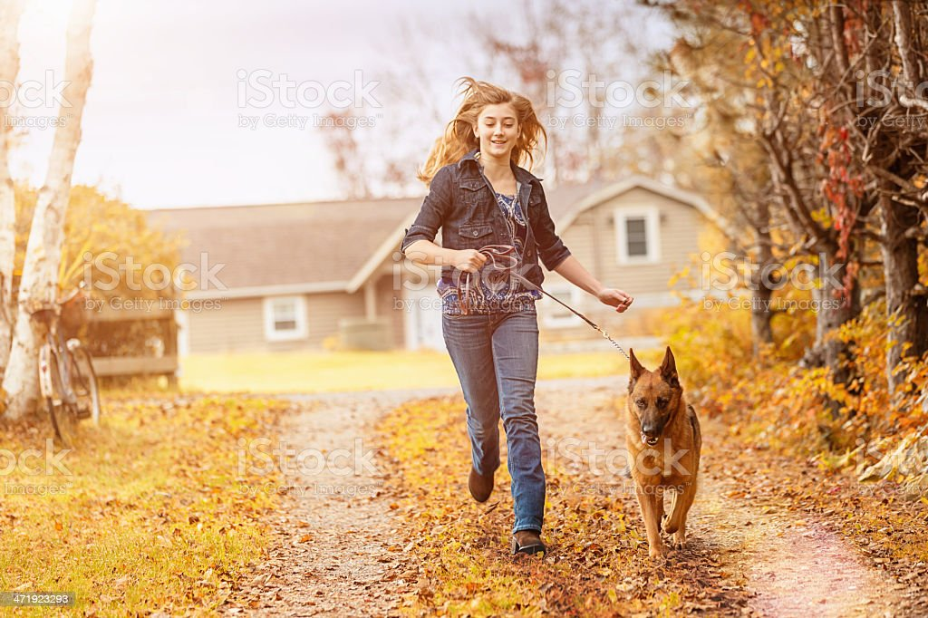 Girl walking with her Dog stock photo