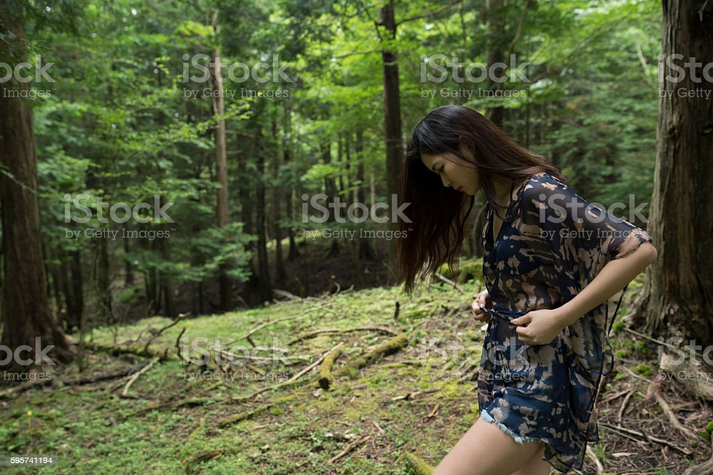 Girl wandering in the forest. stock photo
