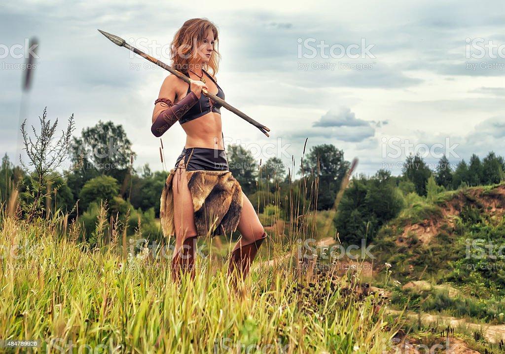 Girl warrior in the field. Amazon on patrol stock photo
