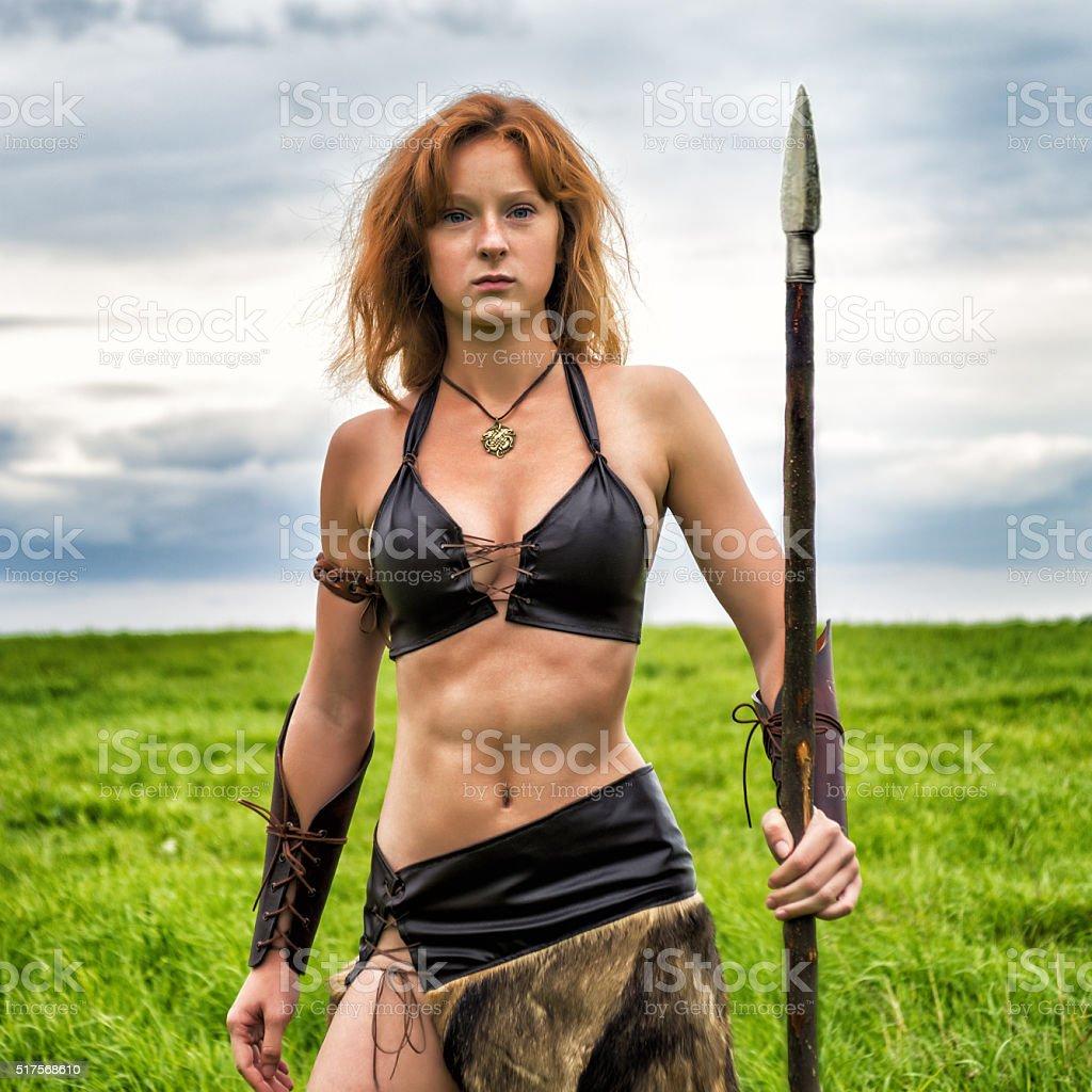 Girl warrior in the field. Amazon on patrol. stock photo