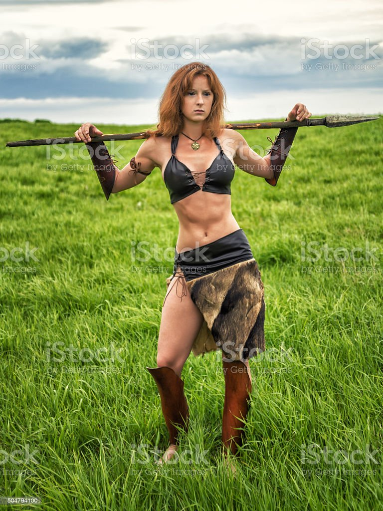 Girl warrior in the field. stock photo