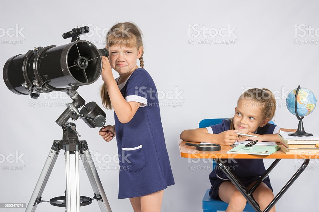 girl was upset he did not see  telescope stock photo