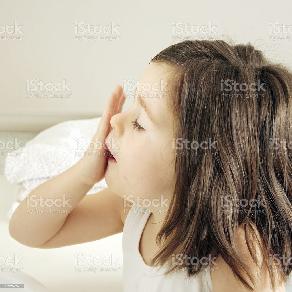 girl washing her face royalty-free stock photo
