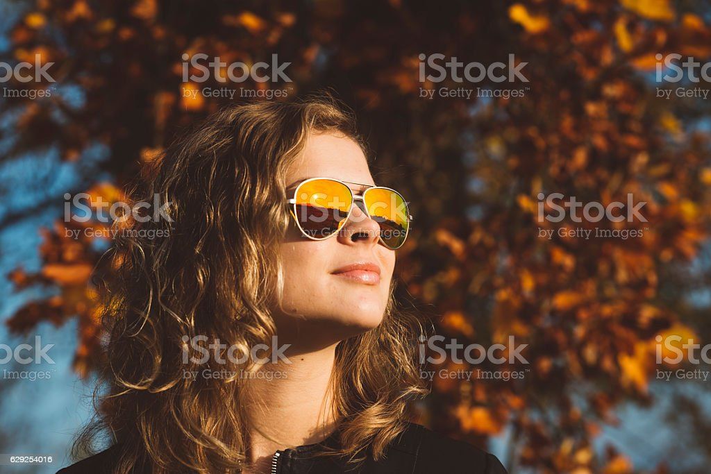 Girl Watches The Sunset in Autumn stock photo