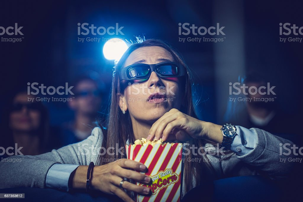 Girl watching a movie stock photo
