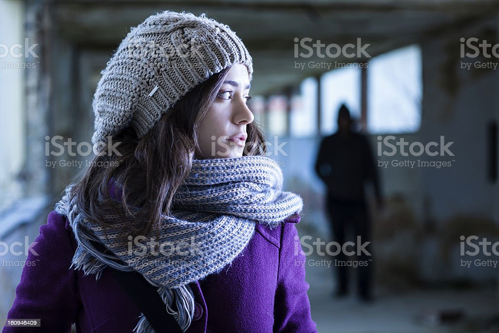Girl watching a stalker over her shoulder stock photo