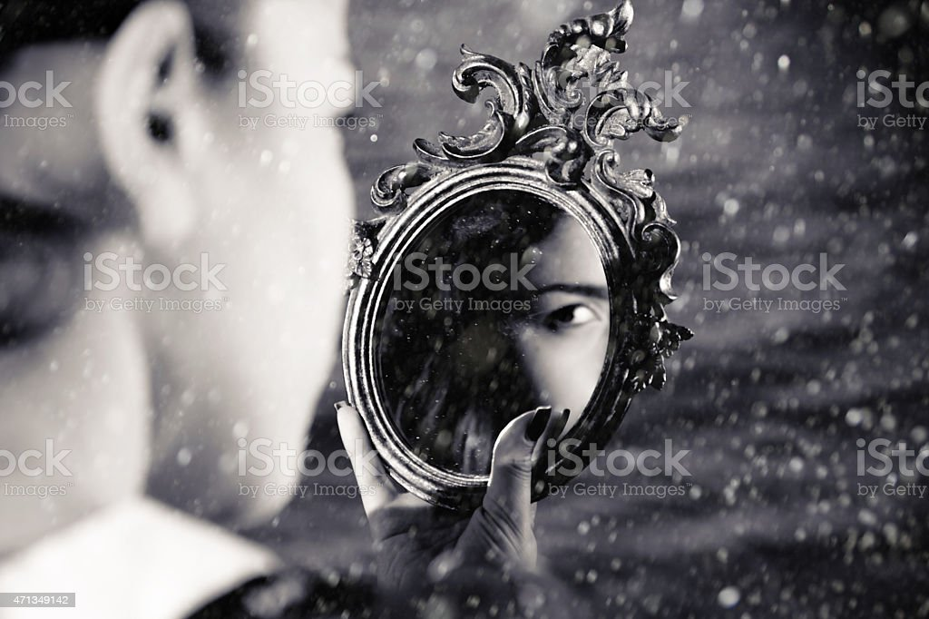 Girl watching mirror stock photo