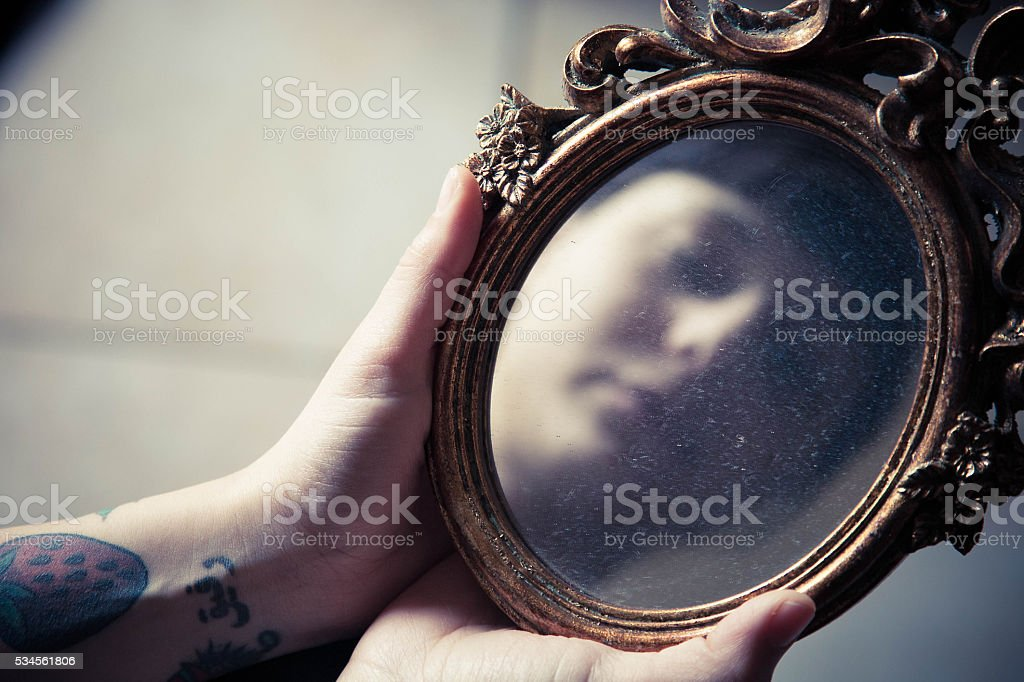 Girl watching mirror stock photo