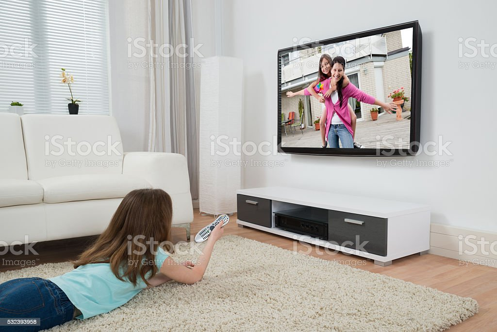Girl Watching Movie On Television stock photo
