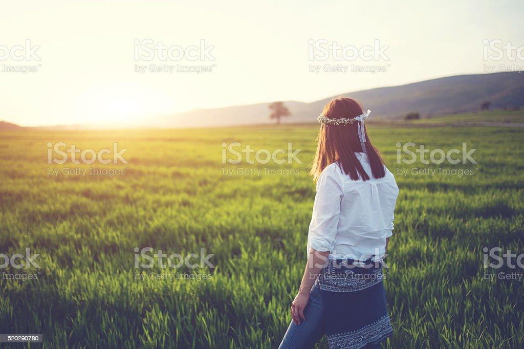 Girl watching sunset stock photo