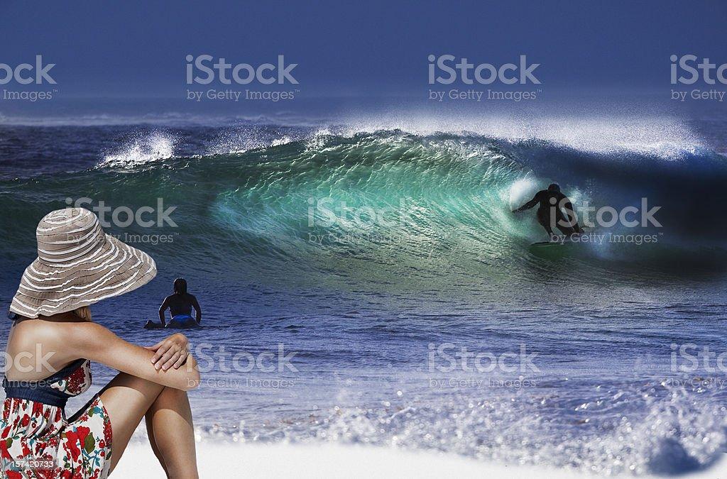 Girl watching surf stock photo