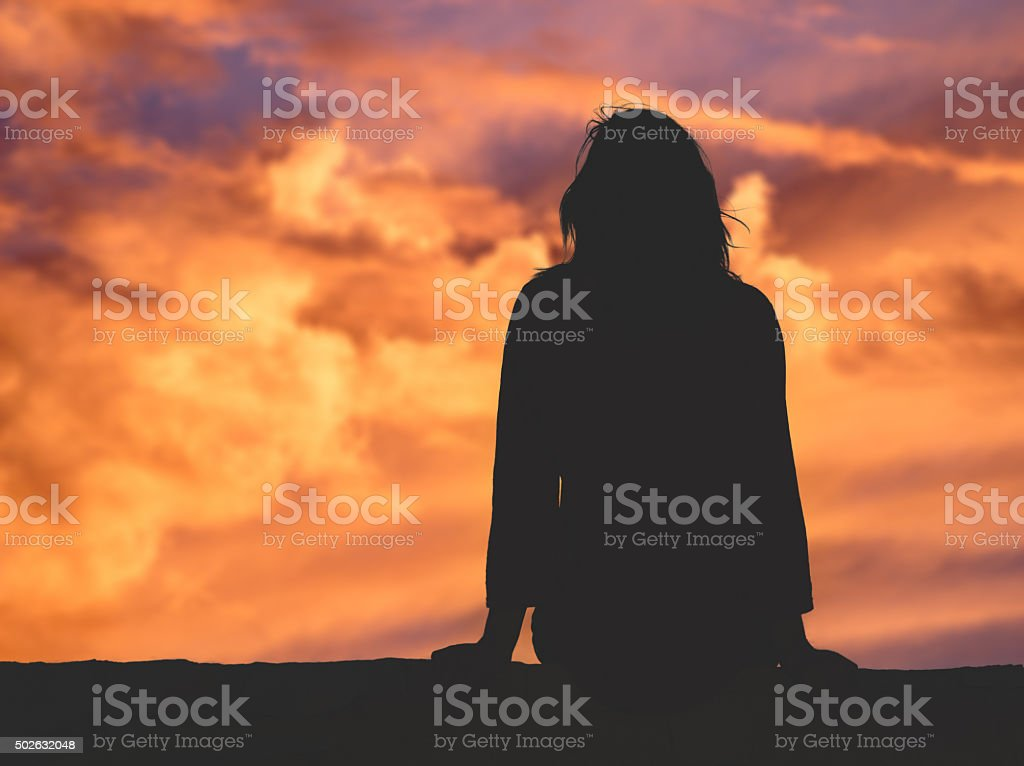 Girl watching the sky. stock photo