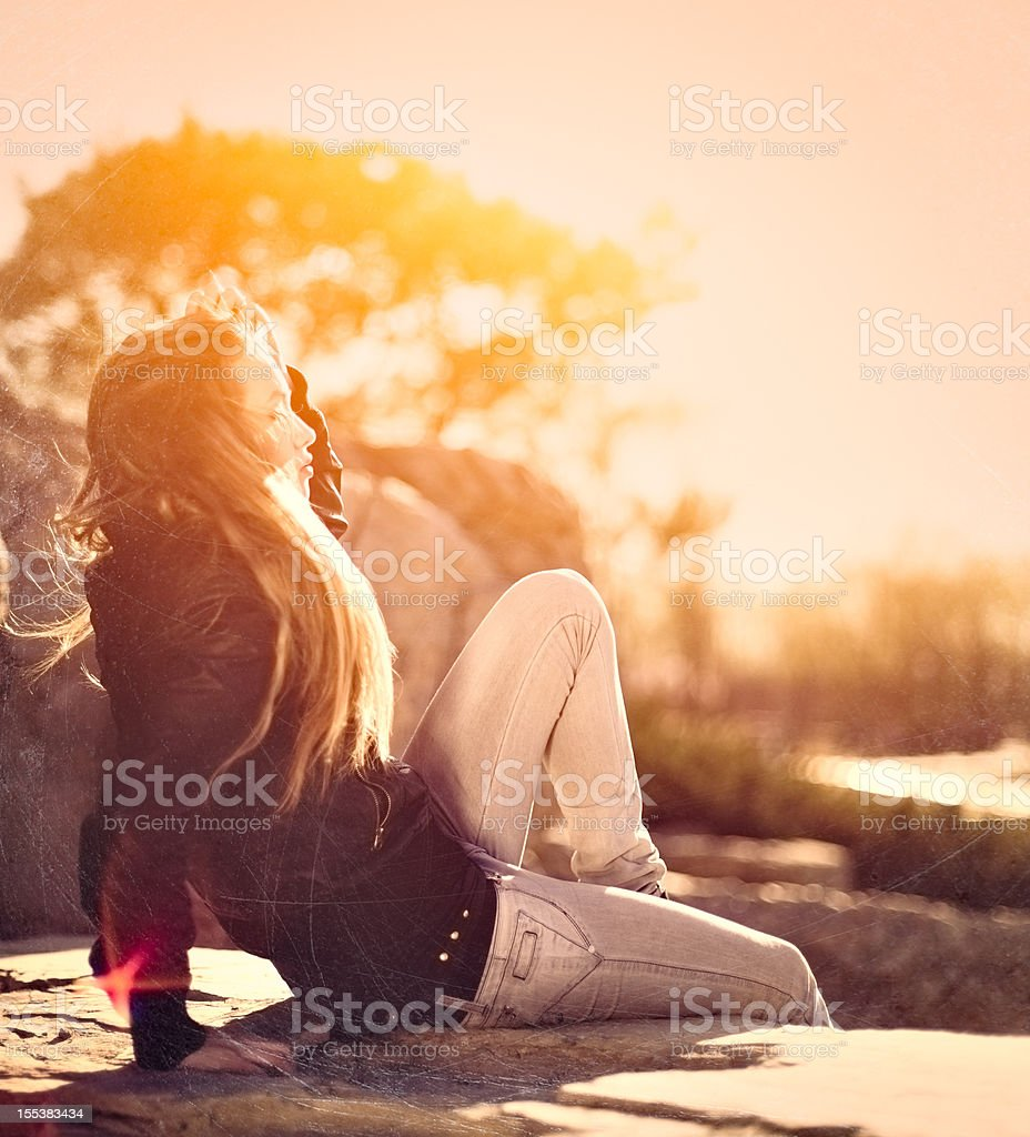 Girl watching the sunset royalty-free stock photo