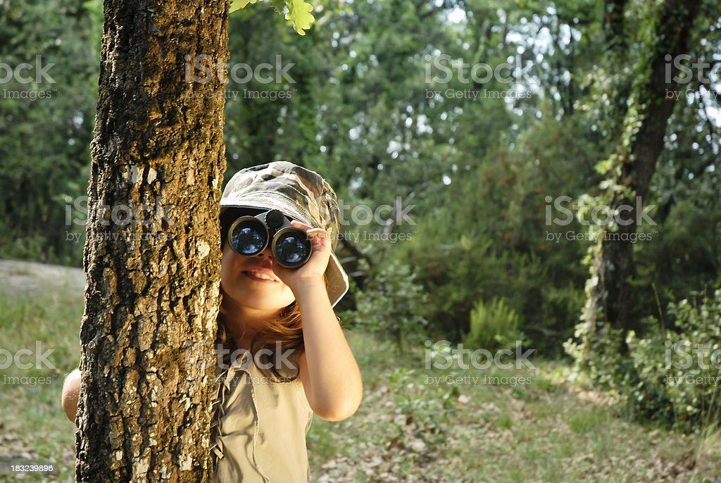Girl watching through binoculars royalty-free stock photo
