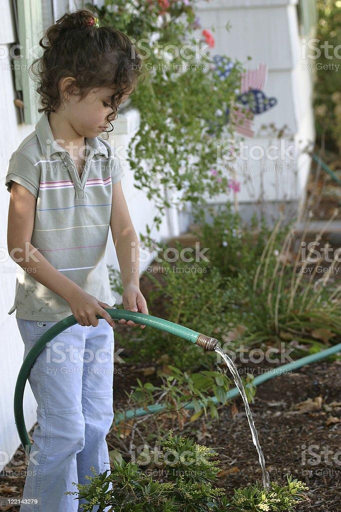 Girl Watering Garden royalty-free stock photo