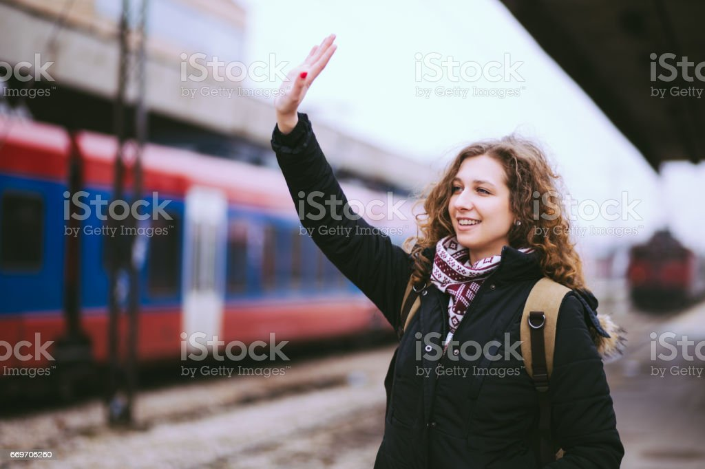 Pretty Curley-haired Woman Waving From Railroad Station Platform.